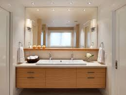sleek framed mirror using standard vanity height with white sink