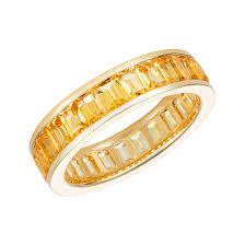 gold eternity ring emerald cut yellow sapphire and yellow gold eternity ring