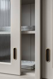 reeded glass kitchen cabinet doors swedish style manor house detailing in a traditional