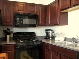 kitchen with black appliances rustic brown ceramic floor tile