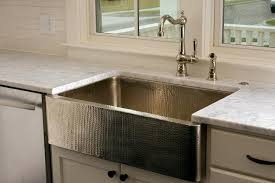 Kitchen Bay Window With Hammered Farmhouse Sink Transitional - Apron sink with backsplash