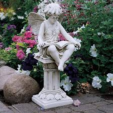 the reading garden statue how lovely bookish