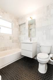 bathroom design with basketweave tiles floor white bathroom