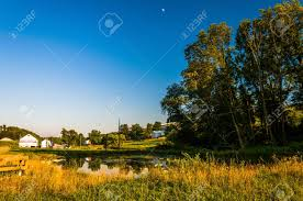 pond and trees on a farm in rural york county pennsylvania stock