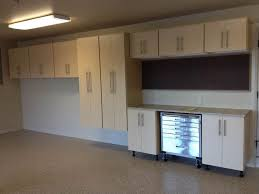 Metal Cabinets For Garage Storage by White Wooden Double Door Storage Cabinet On Gray Painted Wall Room
