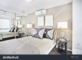 comfortable sheets comfortable bed pillows lamps bedroom bed stock photo 512958157