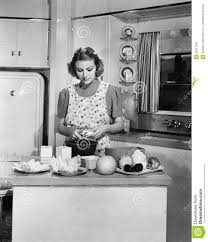 young woman preparing food in the kitchen stock photo image