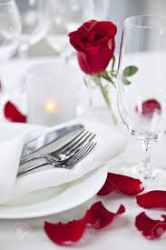 romantic table settings romantic table setting with rose petals plates and cutlery stock