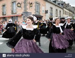 brittany french women in traditional dress dancing in the street