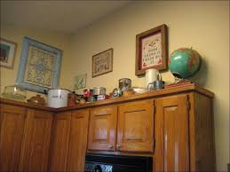 Decorating Above Kitchen Cabinets Ideas by Kitchen Top Of Kitchen Cabinet Decor Distressed Kitchen Cabinets