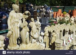 statues and ornaments on sale at garden centre stock photo