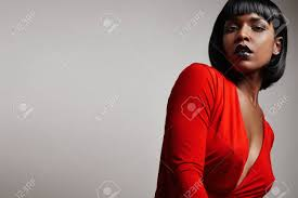 black woman with a straight short hair wearing red dress stock