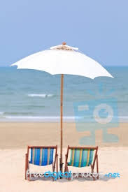 Beach Umbrella And Chairs Beach Chairs And White Umbrella Stock Photo Royalty Free Image