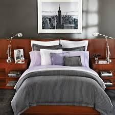 bedroom art painting design with dark gray accent wall for