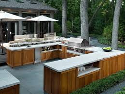 teak outdoor kitchen cabinets kitchen fireplace hearth lake view