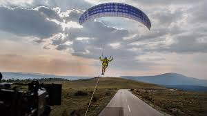 volvo big truck volvo truck performs big stunt with paraglider and bridge