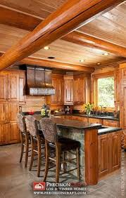 Log Cabin Kitchen Ideas White Kitchen With Log Cut Out Eating Area Dream Home