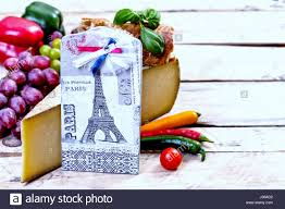 french food ingredients and a decoupage on little platter with