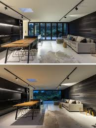 the dark wood exterior of this house flows through to the interior