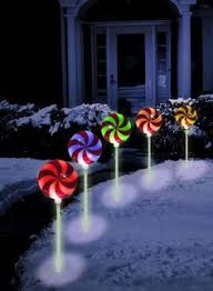 set of 4 lighted glittered lollipop path stakes christmas yard
