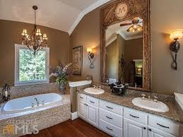 Pendant Light In Bathroom Traditional Master Bathroom With Drop In Bathtub U0026 Wall Sconce In