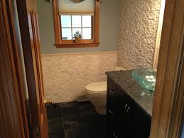 custom half bath with puebla split face on walls with matching
