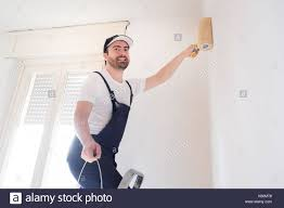 painting a wall painter stock photos u0026 painter stock images alamy