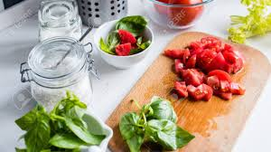 ingr馘ients cuisine fresh basil in a mortar chopped tomatoes and ingredients for