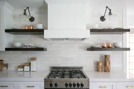 kitchen chandelier white open shelves electric range range hood