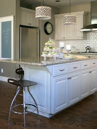 green kitchen cabinets with white island customize your kitchen with a painted island hgtv