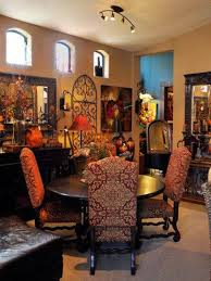 tuscan style dining room with mirrors and wrought iron decor and
