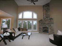 living room with high ceilings large windows and corner
