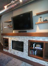 tv fireplace entertainment center with white brick tile stratagem