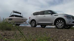 nissan armada vs infiniti qx80 tow test 2012 infiniti qx56 takes a boat for 0 60 mph the fast