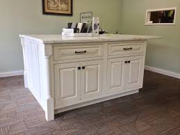 kitchen island in beaded inset cabinetry with raised panel doors kitchen island in beaded inset cabinetry with raised panel doors and drawers painted lightly glazed and aged finish