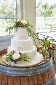 a beautiful australian christmas wedding cake with whimsical