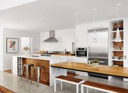 kitchen dining island picturesque lake views connect a family to the outdoors in