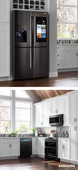 pictures of white kitchen cabinets with black stainless appliances sleek black stainless steel