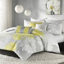 Yellow And Grey Bedroom Table With Typewriter And Yellow Chair In - Grey and yellow bedroom designs