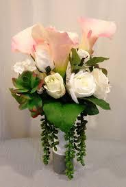 calla lily rose and succulent plant arrangement in ceramic vase