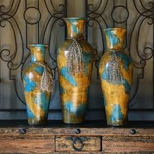 tuscan old world vases statues urns containers