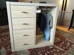ikea hack of kallax shelf to make a montessori wardrobe with 4
