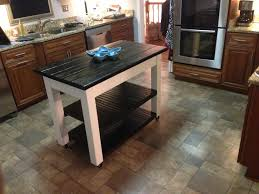 furniture movable kitchen island with shelves and black top for