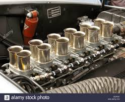 ferrari engine carburetor trumpets on a classic 12 cylinder ferrari engine stock