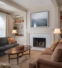 beige fireplace mantels bedroom transitional with built in window