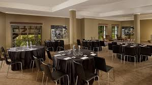 viscondessa iii penha longa resort meeting tables in a large room with columns and windows