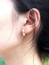 ear studs images cylinder white marble ear studs in gold arva co