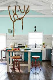 black modern kitchen cabinets very small and long faucet some white modern plates and cups and