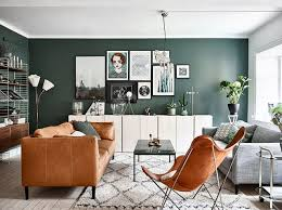 Creative Ways To Rethink Your Living Room Layout Color Palate - Hunter green leather sofa