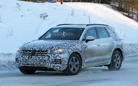 new volkswagen touareg begins to take shape in latest spy photos